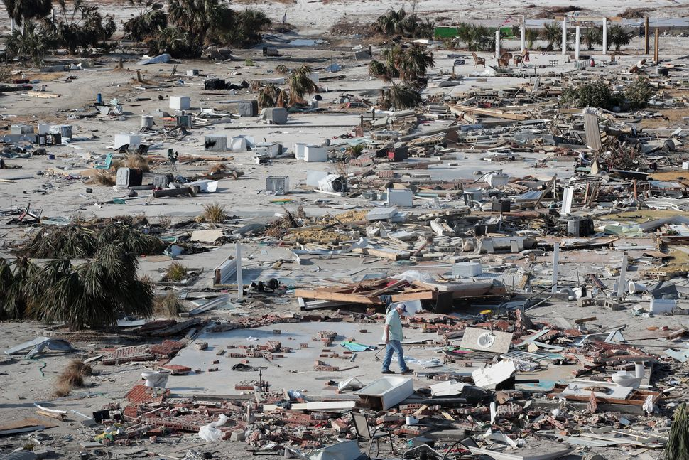 A man walks through a beachfront neighborhood that was decimated by Hurricane Michael in Mexico Beach. The neighborhood, whic