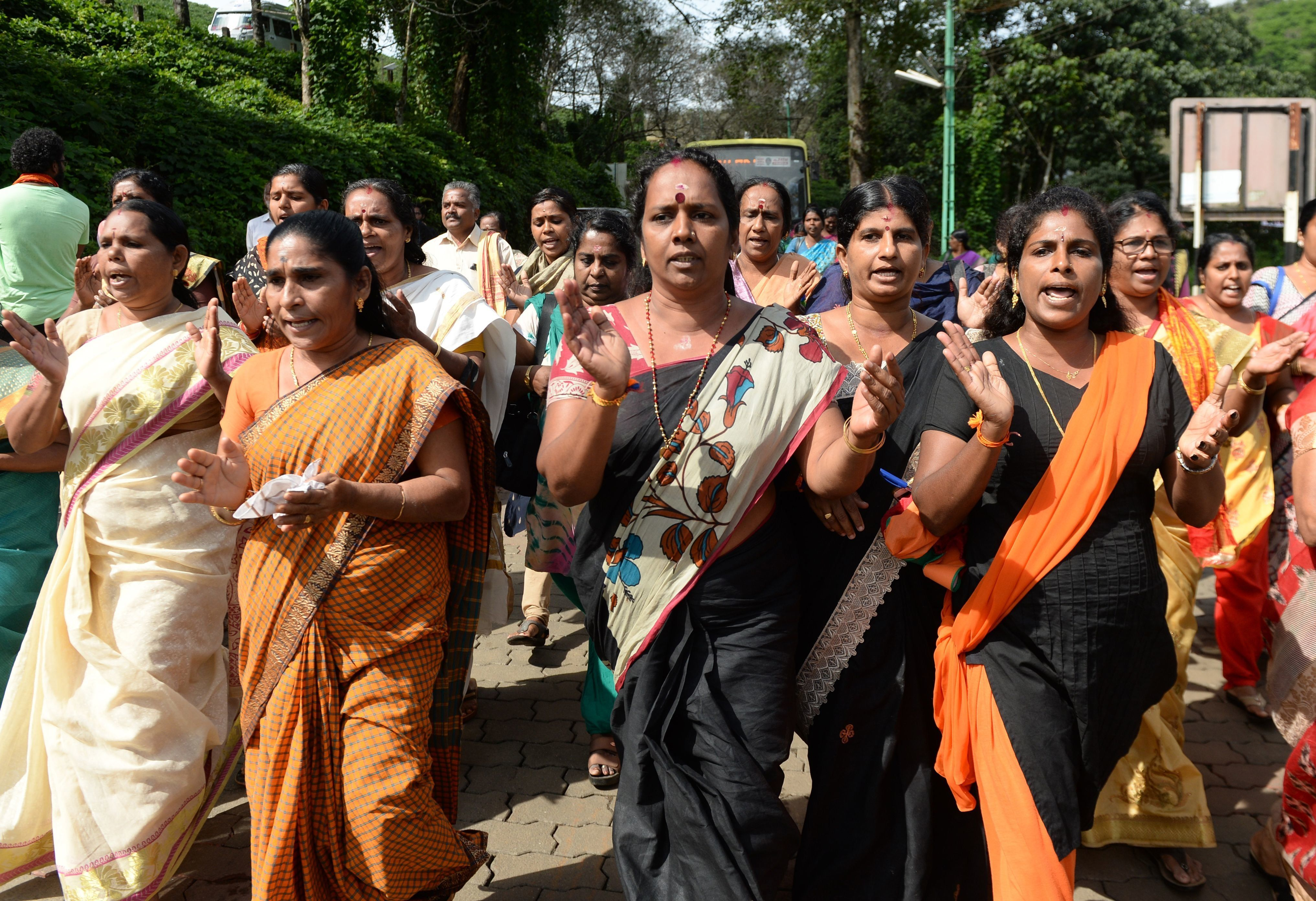 Female devotees also protested against the decision to allow women between ages 10 and 50 to enter