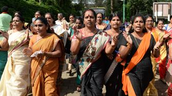Indian Hindu devotees and activist shout slogans praising the Hindu God Ayyapa during a protest against the Supreme Court verdict revoking a ban on women's entry to Sabarimala's Ayyappa Hindu temple, in Nilackal in the southern Kerala state on October 17, 2018. - Indian police on October 17 cleared protesters trying to stop women accessing one of Hinduism's most sacred sites, a hilltop temple forced by judges to open its doors to all female pilgrims for the first time. The Supreme Court in September overturned a ban on women of menstruating age, between 10 and 50, entering and praying at the Ayyappa temple at Sabarimala in the southern state of Kerala. (Photo by ARUN SANKAR / AFP)        (Photo credit should read ARUN SANKAR/AFP/Getty Images)