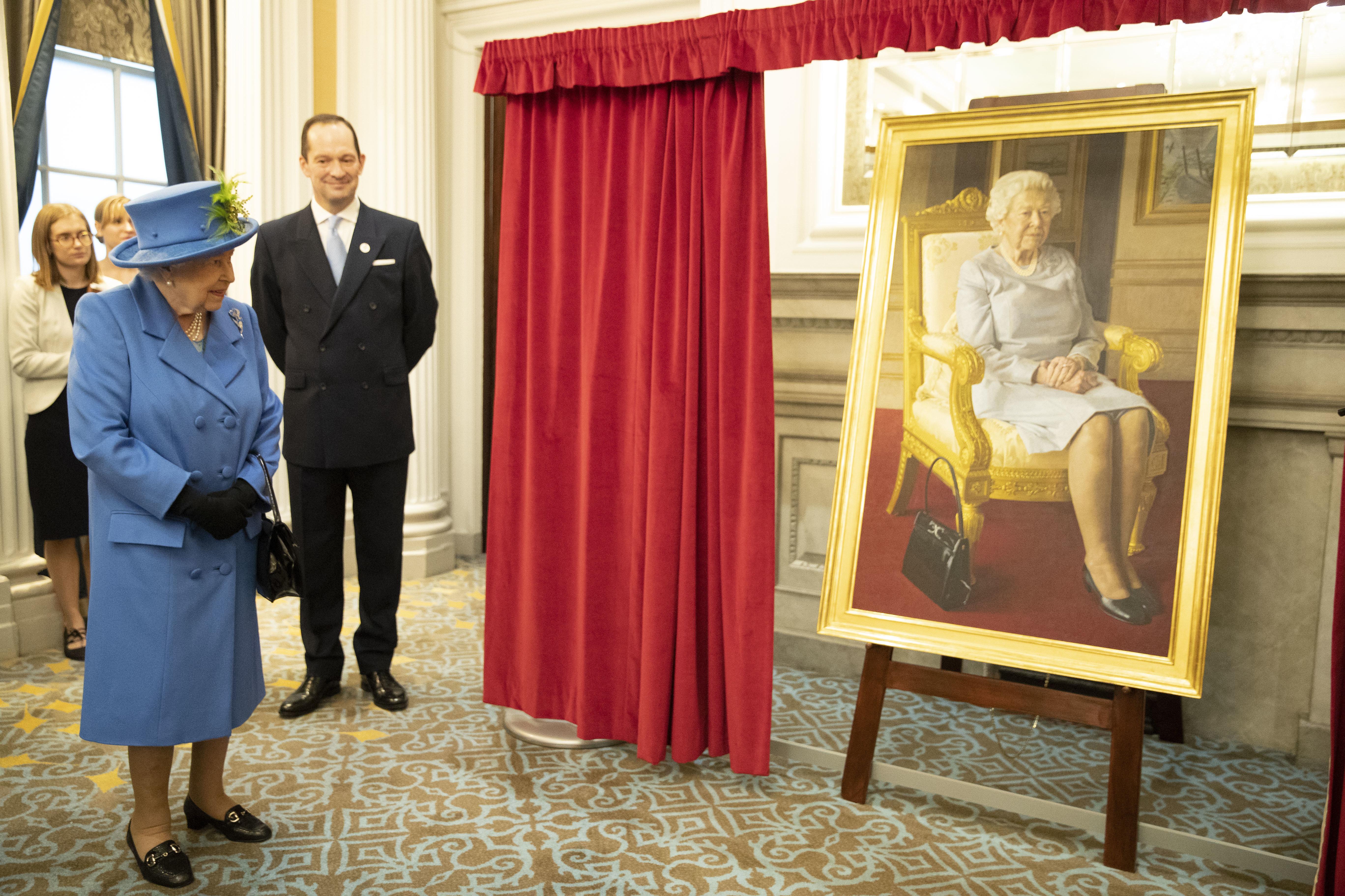New Portrait Of Queen Elizabeth II Features Her Constant Companion: Her Purse