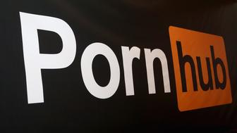 LAS VEGAS, NV - JANUARY 24:  A Pornhub logo is displayed at the company's booth during the 2018 AVN Adult Expo at the Hard Rock Hotel & Casino on January 24, 2018 in Las Vegas, Nevada.  (Photo by Gabe Ginsberg/FilmMagic)