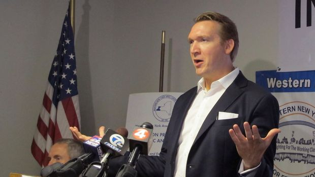 In this Oct. 11, 2018, photo, Democratic congressional candidate Nate McMurray speaks to supportive union members at United Steelworkers Local 2603 in Blasdell, N.Y. McMurray is challenging Republican incumbent Chris Collins, who is running for re-election while under federal indictment for alleged insider trading. (AP Photo/Carolyn Thompson)