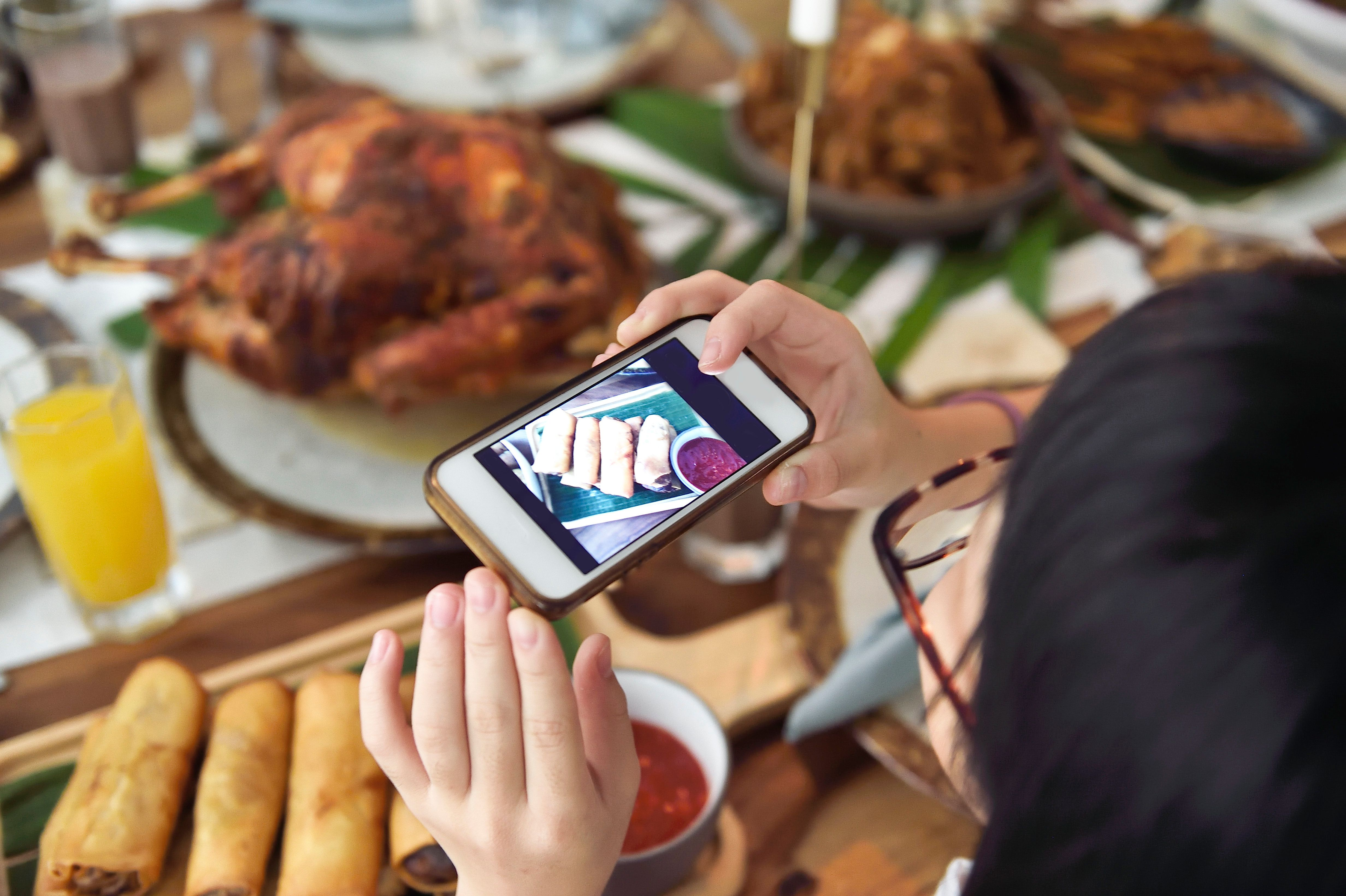 PHONE ADDICTION: More Than Half Of Us Can't Get Through Dinner Without Checking Our
