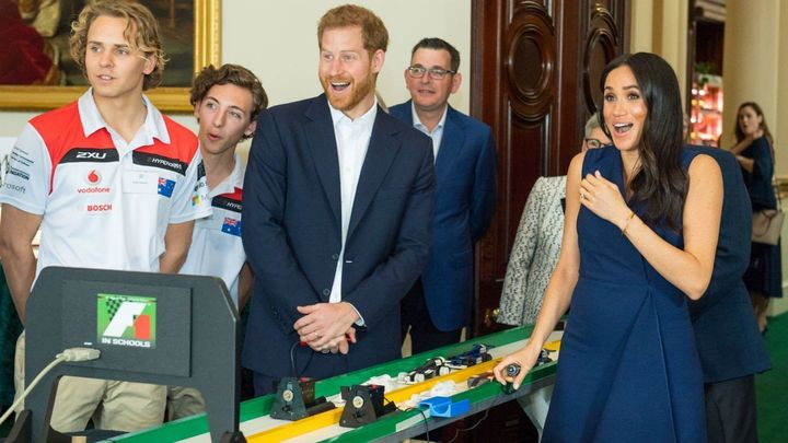 The Duchess of Sussex reacts after the big bang to start the students' mini-Formula 1 racing demonstration.