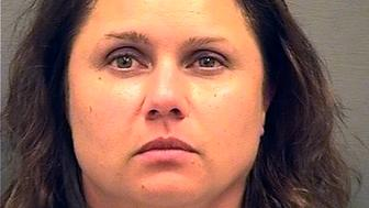 This image provided by the Alexandria Sheriff's Department shows a mug shot of Natalie Mayflower Edwards. Natalie Mayflower Sours Edwards, a Treasury Department employee, has been accused of leaking confidential banking reports of suspects charged in special counsel Robert Mueller's investigation. (Alexandria Sheriff's Department via AP)