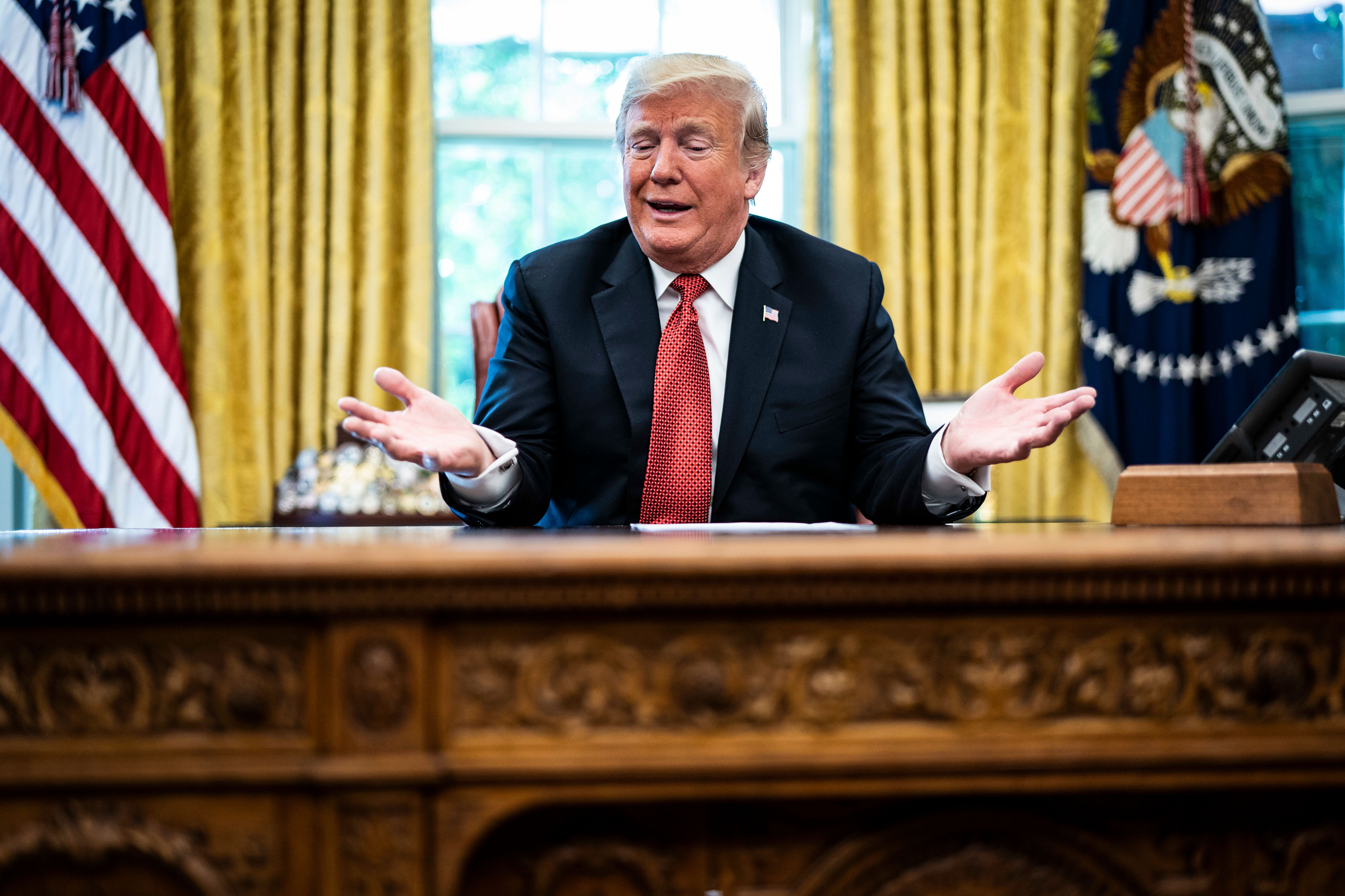 WASHINGTON, DC - OCTOBER 17 : President Donald J. Trump speaks during a meeting with workers titled Cutting the Red Tape, Unleashing Economic Freedom in the Oval Office of the White House on Wednesday, Oct. 17, 2018 in Washington, DC. (Photo by Jabin Botsford/The Washington Post via Getty Images)