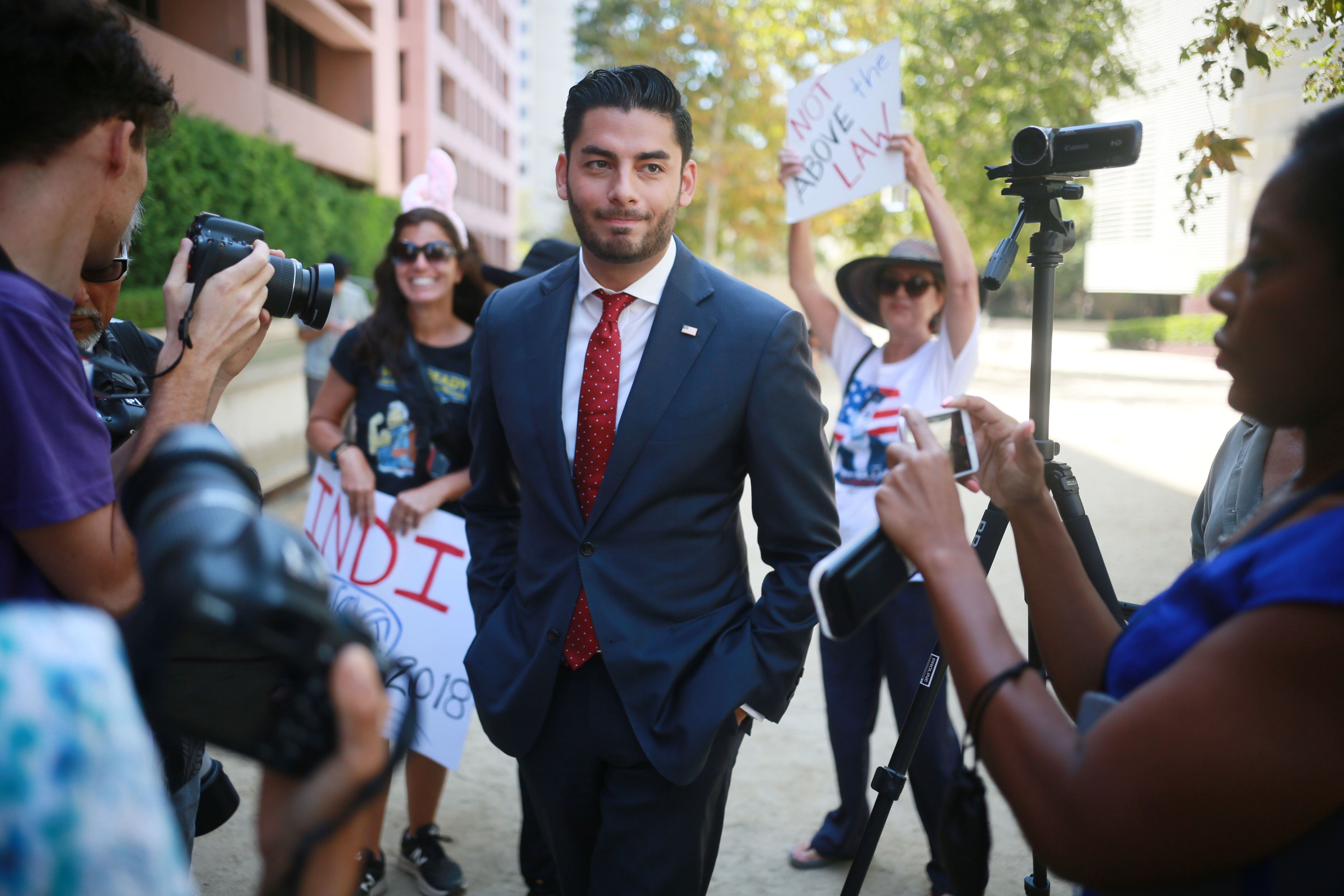 SAN DIEGO, CA - AUGUST 23: Ammar Campa-Najjar, who is running against Congressman Duncan Hunter, speaks to reporters outside the San Diego Federal  Courthouse during Congressman Hunter's arraignment hearing on Thursday, August 23, 2018 in San Diego, CA.  Hunter and his wife Margaret, who pled 'not guilty', are accused of using more than 250,00 in campaign funds for personal use. (Photo by Sandy Huffaker/Getty Images)