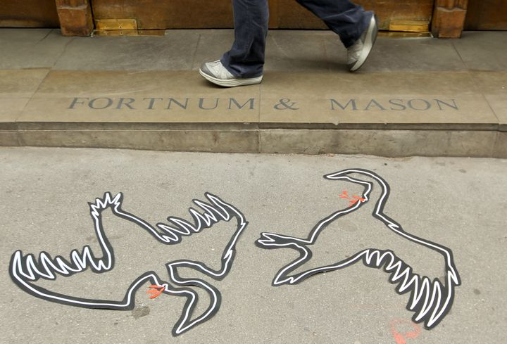 Chalk body outlines of geese — part of a PETA protest against the sale of foie gras at Fortnum & Mason in London. B