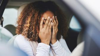 Cropped shot of a young woman looking stressed-out while sitting in her car
