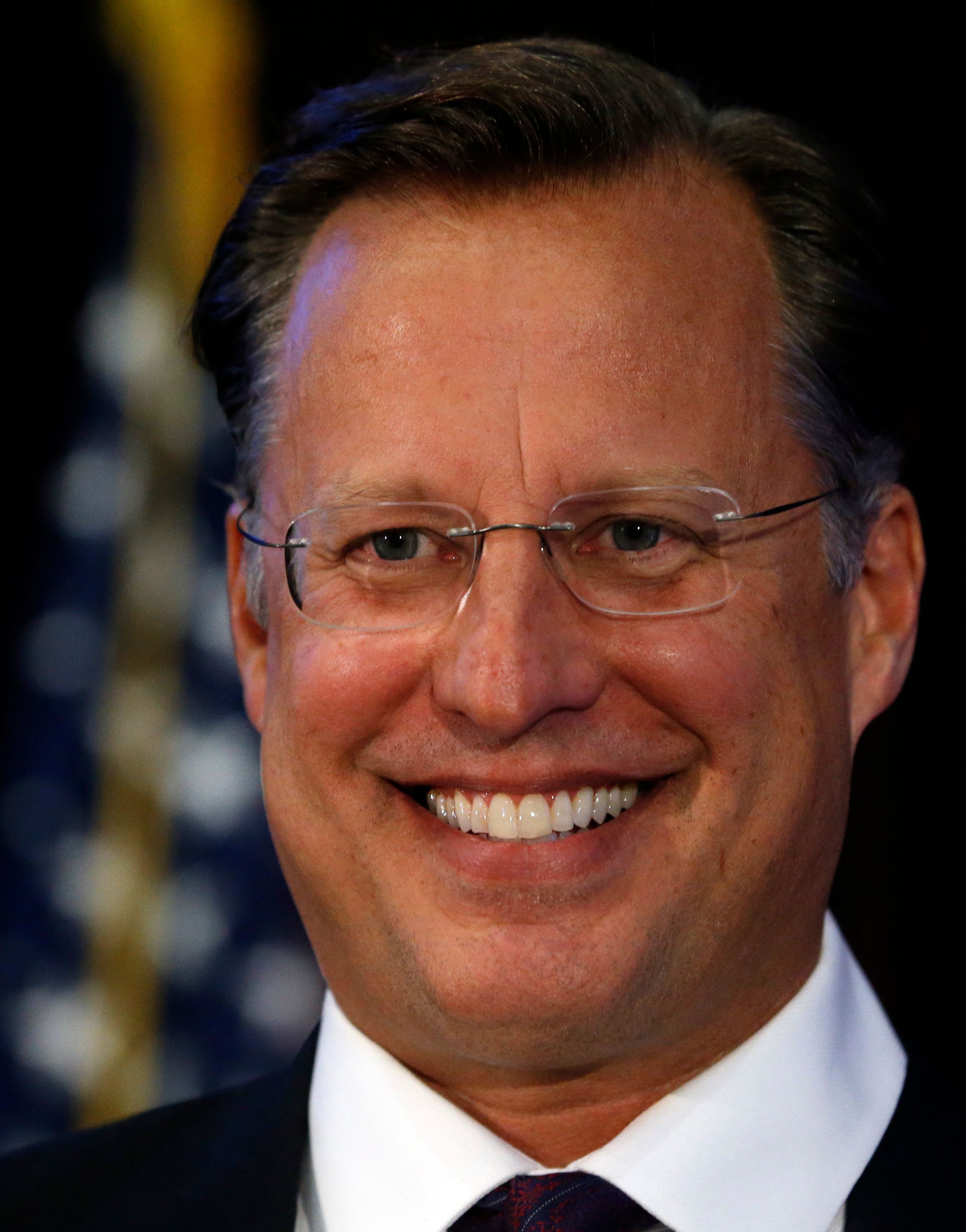 Virginia Congressman Dave Brat, R-Va., smiles during a microphone check prior to a debate with Democratic challenger Abigail Spanberger at Germanna Community College in Culpeper, Va., Monday, Oct. 15, 2018. (AP Photo/Steve Helber)