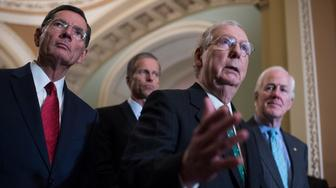 UNITED STATES - OCTOBER 10: From left, Sens. John Barrasso, R-Wyo., John Thune, R-S.D., Senate Majority Leader Mitch McConnell, R-Ky., and John Cornyn, R-Texas, conduct a news conference in the Capitol after the Senate Policy luncheons on October 10, 2018. (Photo By Tom Williams/CQ Roll Call)