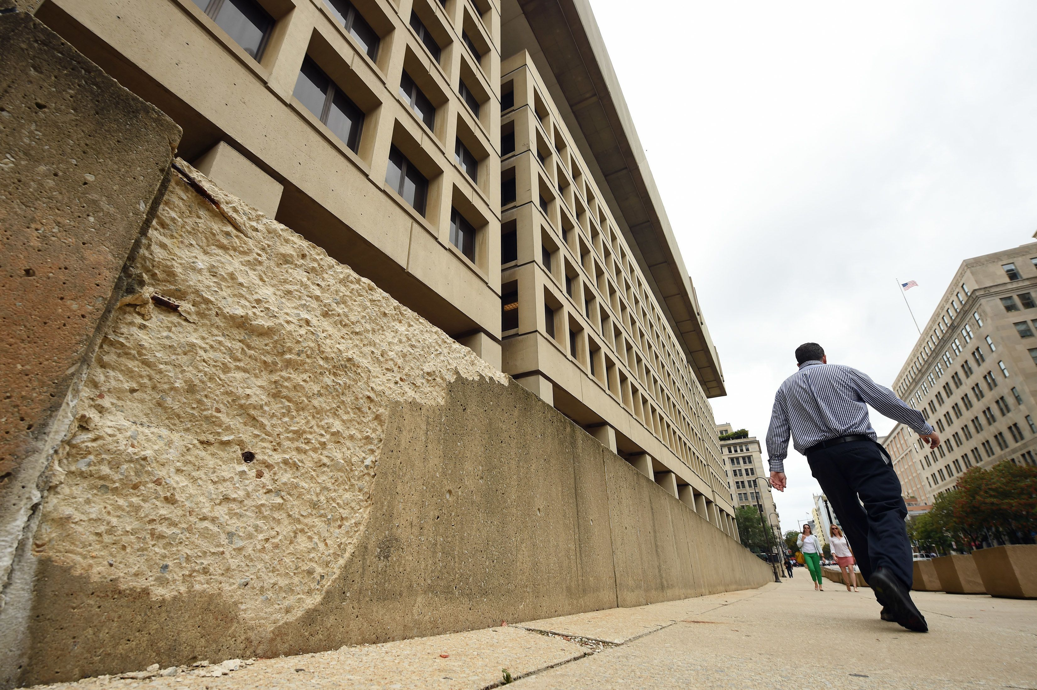 WASHINGTON, DC - AUGUST 20: A damaged wall surrounding the exterior of the J. Edgar Hoover Building, which is the headquarters of the FBI is seen on Thursday August 20, 2015 in Washington, DC. The agency is looking for a new location for their headquarters. (Photo by Matt McClain/The Washington Post via Getty Images)