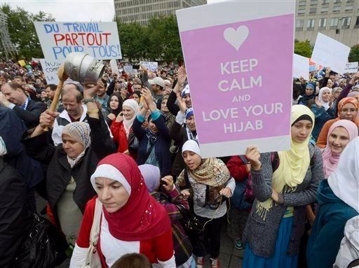 Demonstrators protest a proposal by the Parti Quebecois in 2013 to ban some religious symbols from public...