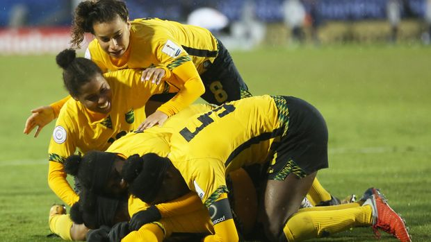 FRISCO, TX - OCTOBER 17: Players of Jamaica celebrate after winning a match between Panama and Jamaica as part of CONCACAF Women's Championship at Toyota Stadium on October 17, 2018 in Frisco, Texas. (Photo by Omar Vega/Getty Images)