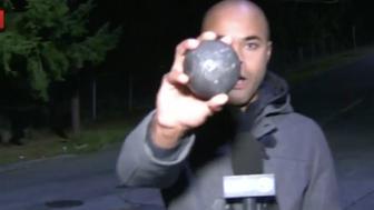 Metal Ball Rolls Down Seattle Street