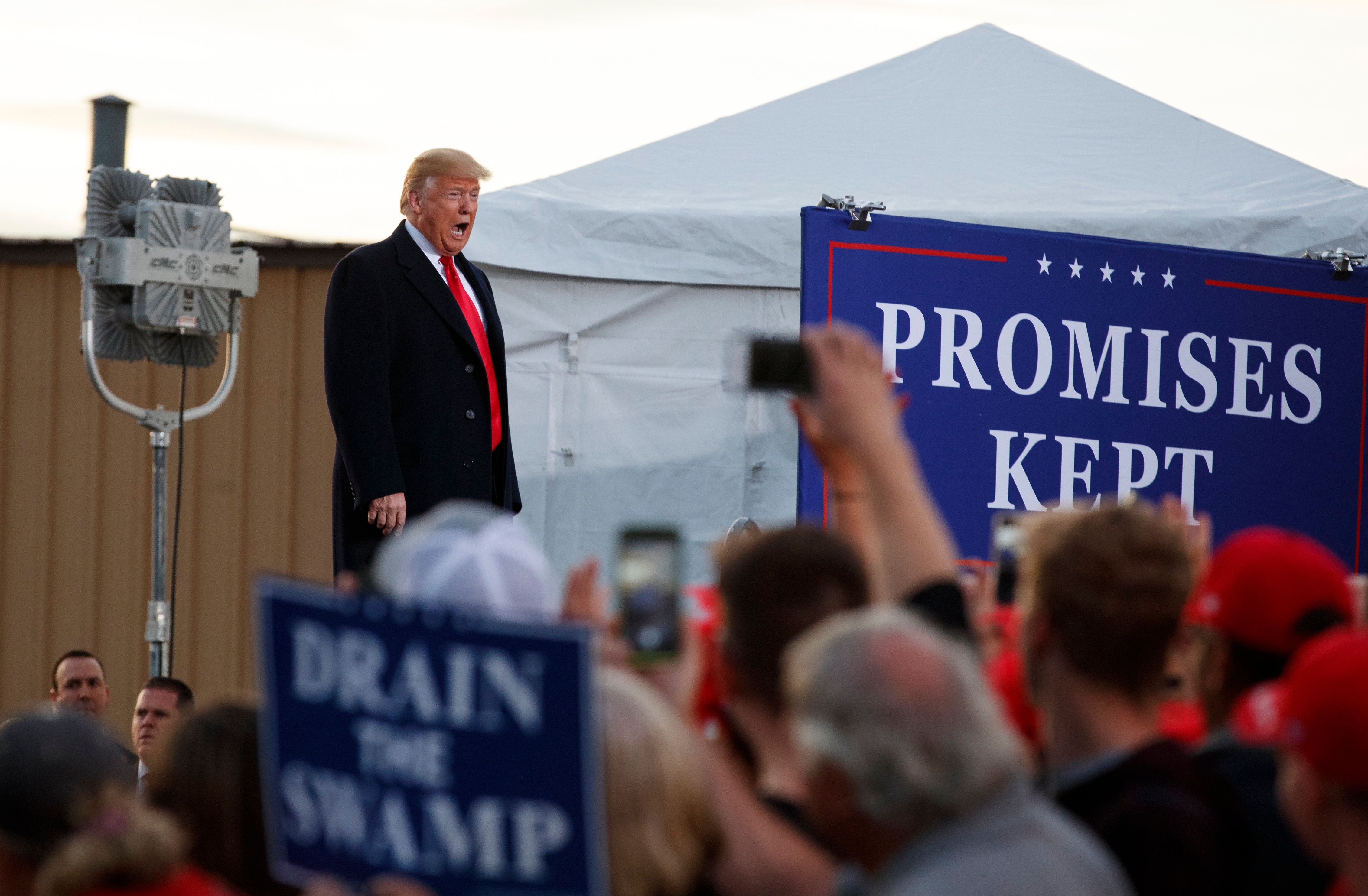 President Donald Trump calls out as he arrives at a campaign rally at Minuteman Aviation Hangar, Thursday, Oct. 18, 2018, in Missoula, Mont. (AP Photo/Carolyn Kaster)