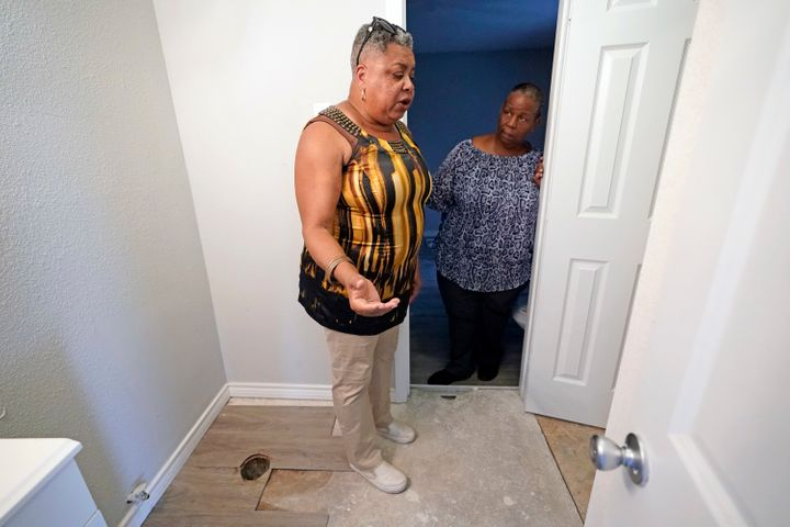 In this Aug. 9, 2018, photo, Shirley Paley, left, talks about surviving through Hurricane Harvey as she stands inside her hom