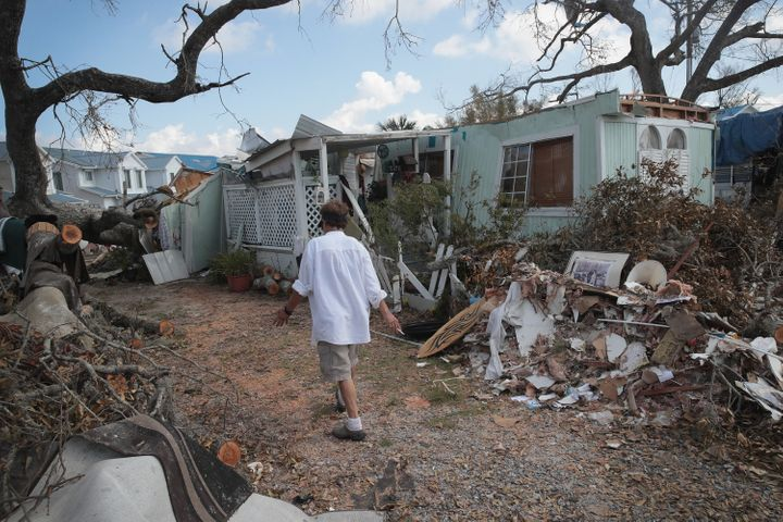 Debbie Powell of Panama City, Florida, walks to her trailer on Oct. 15 in Water's Edge RV Park, which was damaged by Hurrican
