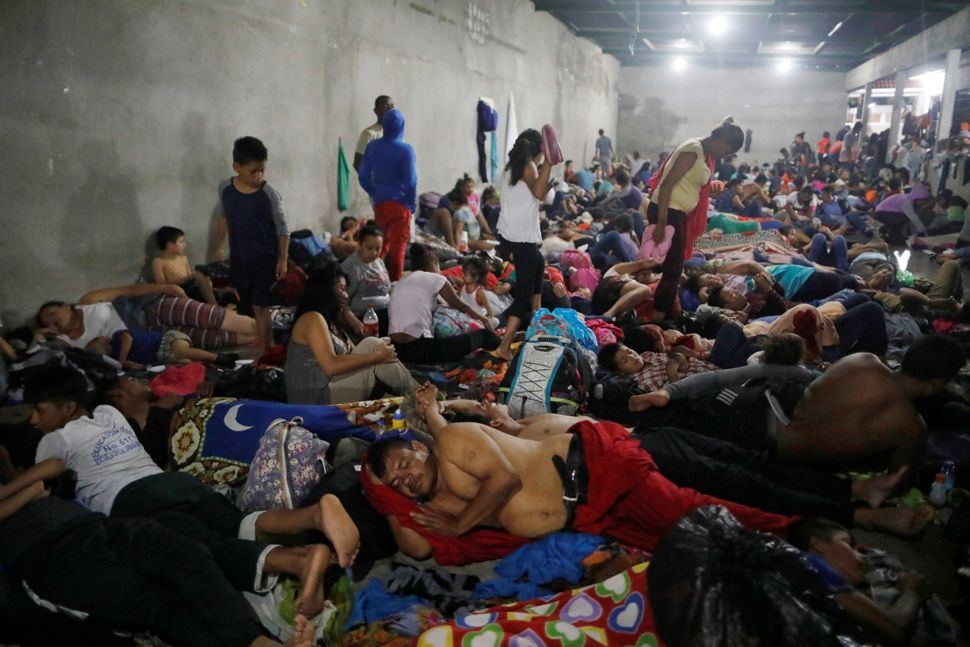Honduran migrants rest inside a shelter in Tecun Uman.