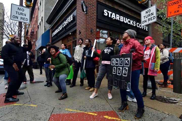 People protest a Philadelphia Starbucks after an employee called the police on two black men sitting in the restaurant.