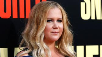 """Cast member Amy Schumer poses at the premiere of the movie """"Snatched"""" in Los Angeles, California, U.S., May 10, 2017.   REUTERS/Mario Anzuoni"""