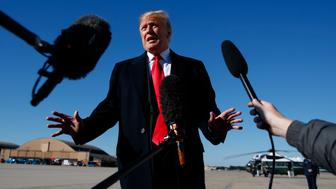 President Donald Trump talks to the media before boarding Air Force One, Thursday, Oct. 18, 2018, in Andrews Air Force Base, Md., en route to campaign stops in Montana, Arizona and Nevada.