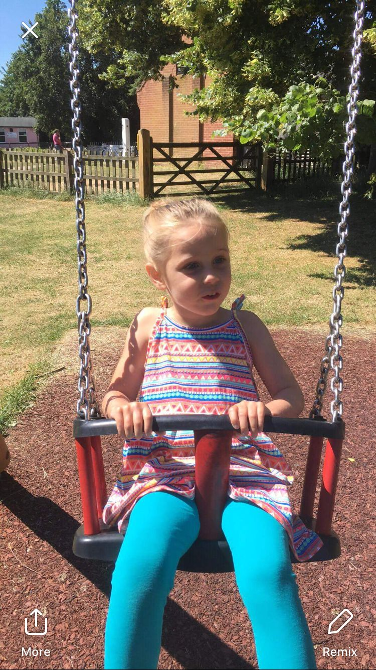 Indie-Rose Clarry on a swing