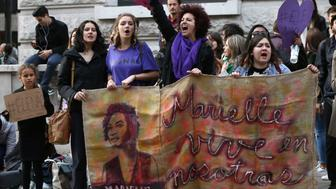 Women protest against right-wing candidate Jair Bolsonaro, of the Social Liberal Party in Brazil's general election outside the Embassy of Brazil in London. (Photo by Yui Mok/PA Images via Getty Images)