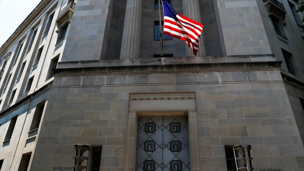 The U.S. Department of Justice headquarters building is seen after Deputy U.S. Attorney General Rod Rosenstein announced grand jury indictments of 12 Russian intelligence officers in special counsel Robert Mueller's Russia investigation in Washington, U.S., July 13, 2018. REUTERS/Leah Millis