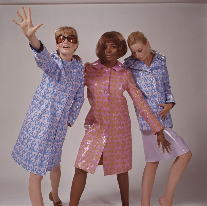 Models in the 1960s show vinyl raincoats.
