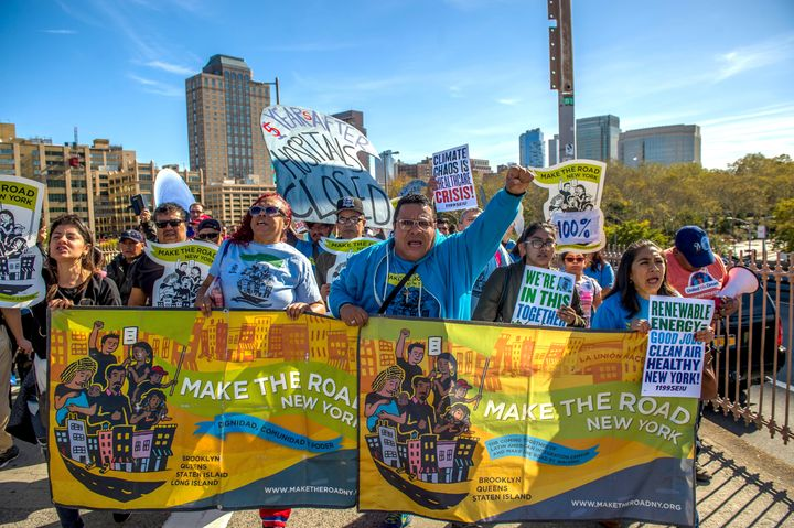 Advocates march in New York on the fifth anniversary of Hurricane Sandy.