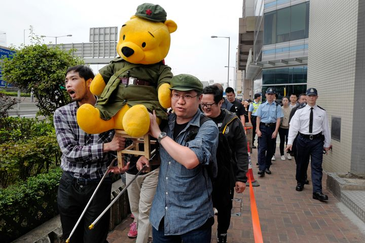 Protesters carry a Winnie the Pooh dressed as Communist Party member to symbolize Chinese President Xi Jinping in Hong Kong o
