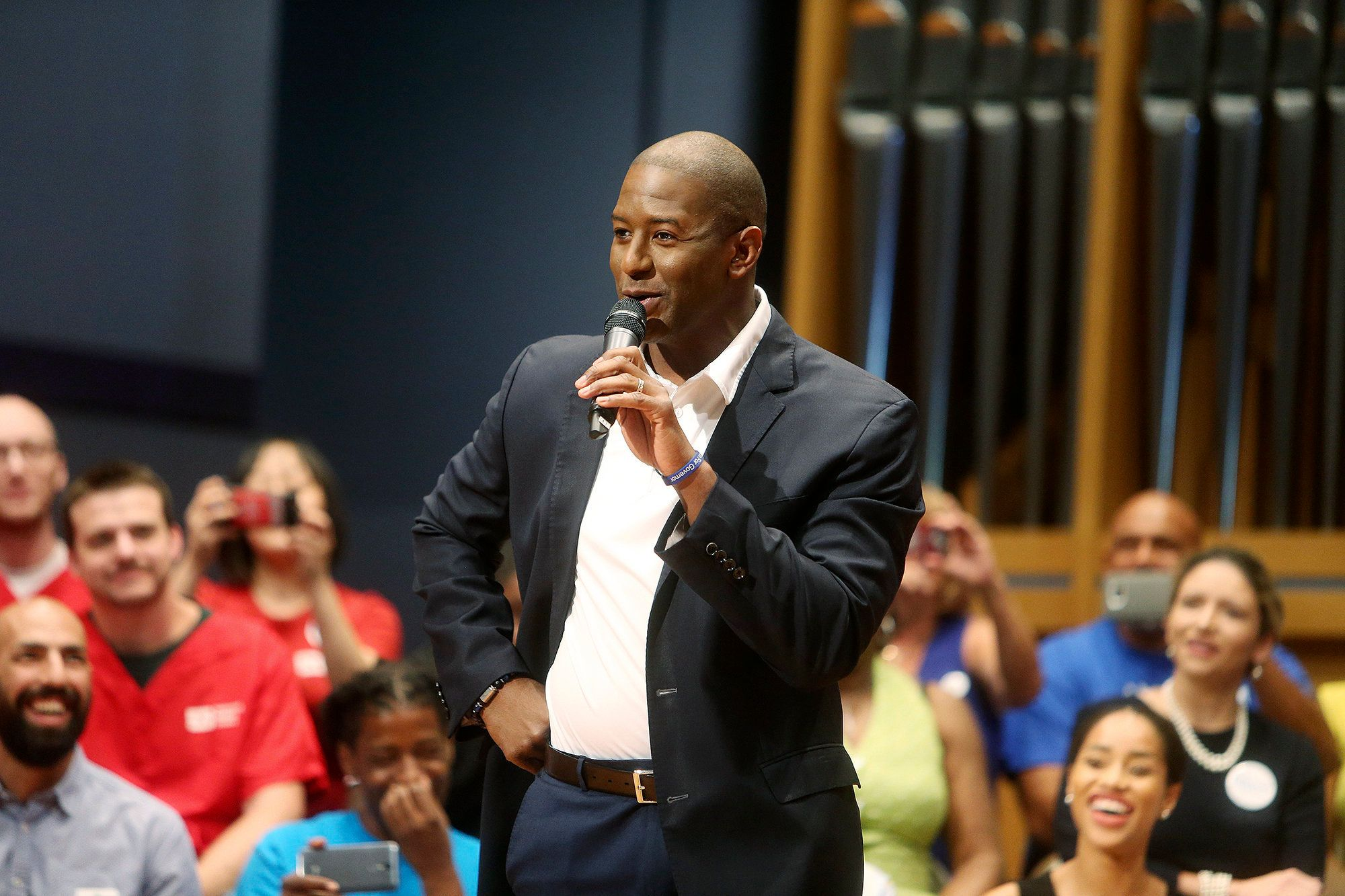 Gubernatorial Democratic candidate Andrew Gillum speaks to a packed music center during a town hall at St. Petersburg College in St. Petersburg, Fla., on Friday, Oct. 19, 2018. (Octavio Jones/Tampa Bay Times via AP)