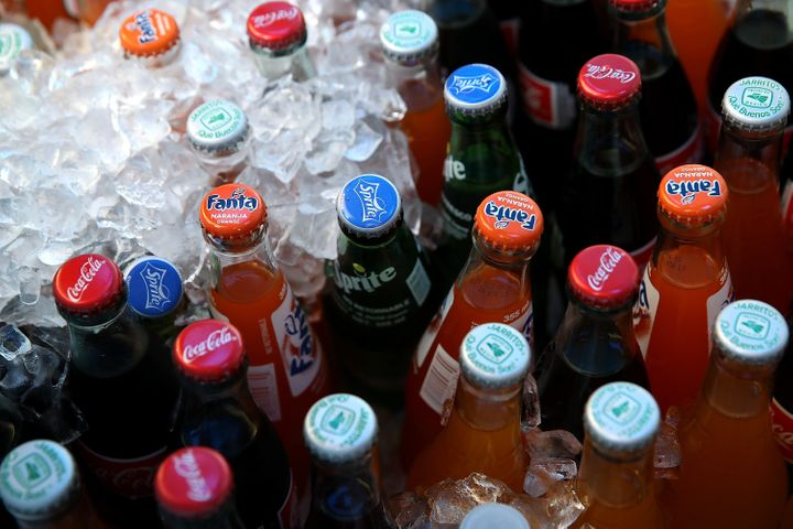 """Ballot initiatives in Washington and Oregon would bar cities from passing new taxes on """"grocery items."""" Soda comp"""