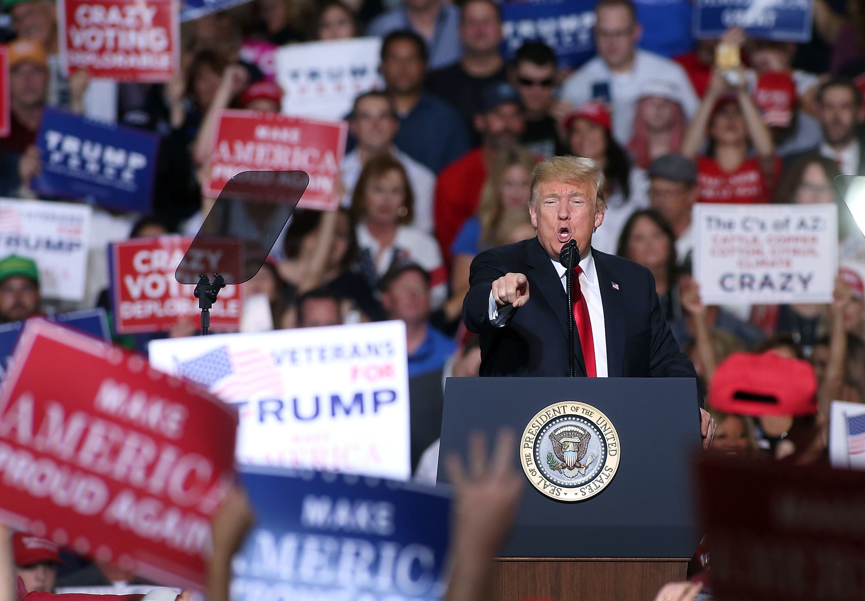 MESA, AZ - OCTOBER 19:  President Donald Trump speaks to a crowd of supporters during a rally at the International Air Response facility on October 19, 2018 in Mesa, Arizona.  President Trump is holding rallies in Arizona, Montana and Nevada, campaigning for Republican candidates running for the U.S. Senate. (Photo by Ralph Freso/Getty Images)