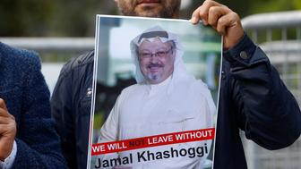 A demonstrator holds picture of Saudi journalist Jamal Khashoggi during a protest in front of Saudi Arabia's consulate in Istanbul, Turkey, October 5, 2018. REUTERS/Osman Orsal