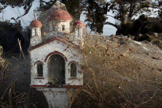 A roadside religious shrine covered in