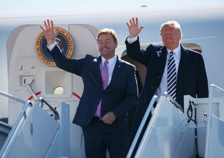 Sen. Dean Heller (R-Nev.) steps off Air Force One with President Donald Trump ahead of a rally in Elko, Nevada, on Saturday.