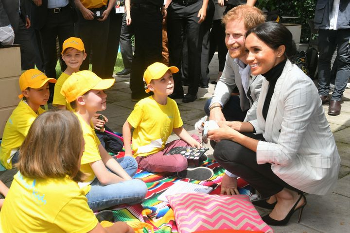 The Duke and Duchess of Sussex chat with school children in Australia.