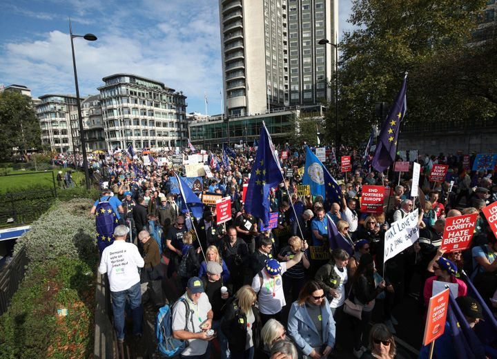Hundreds of thousands of supporters of the European Union marched through London on Saturday to demand that the British gover