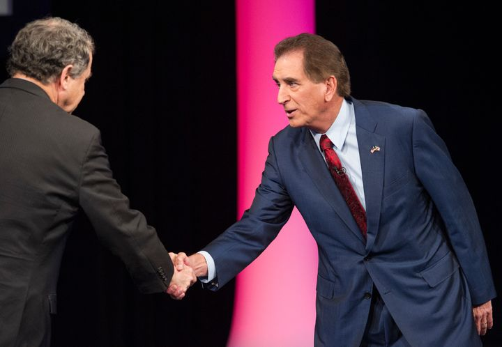 Brown (left) shakes hands with Renacci during an October debate.