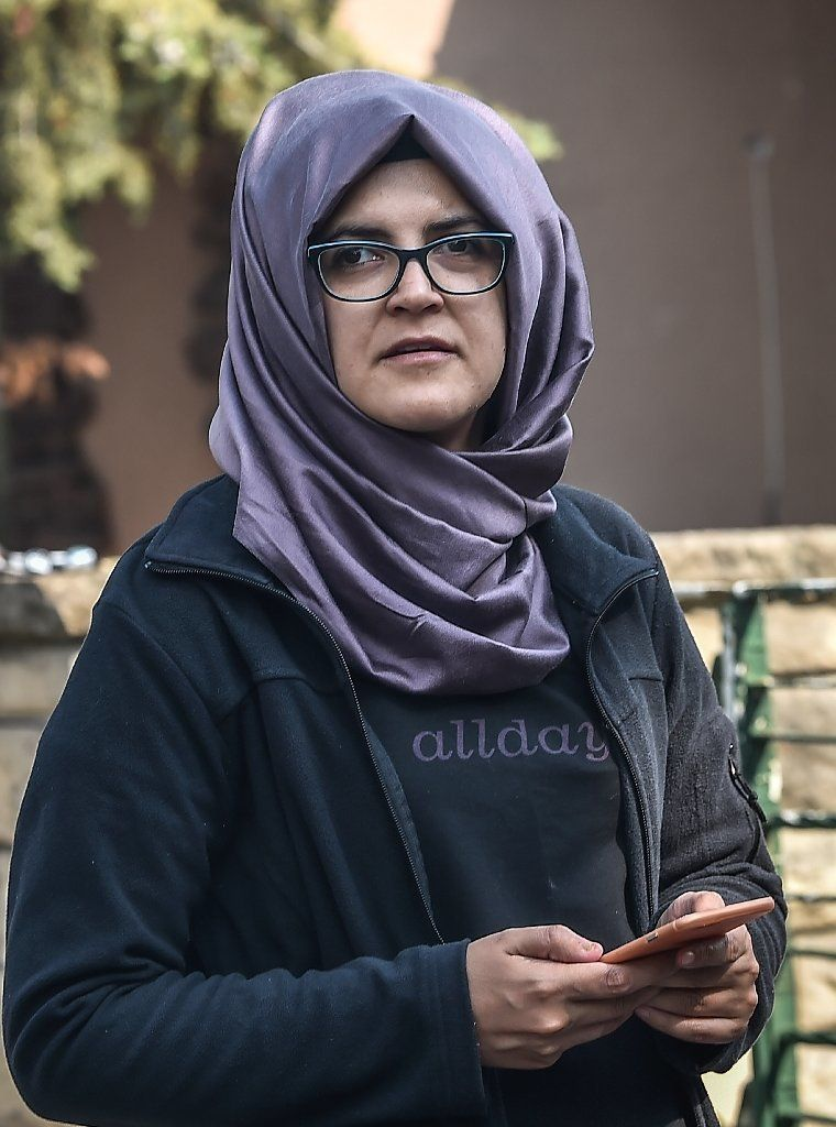 Missing journalist Jamal Khashoggi's Turkish fiancee Hatice Cengiz is seen waiting in front of the Saudi Arabian consulate in Istanbul (AFP Photo/OZAN KOSE)
