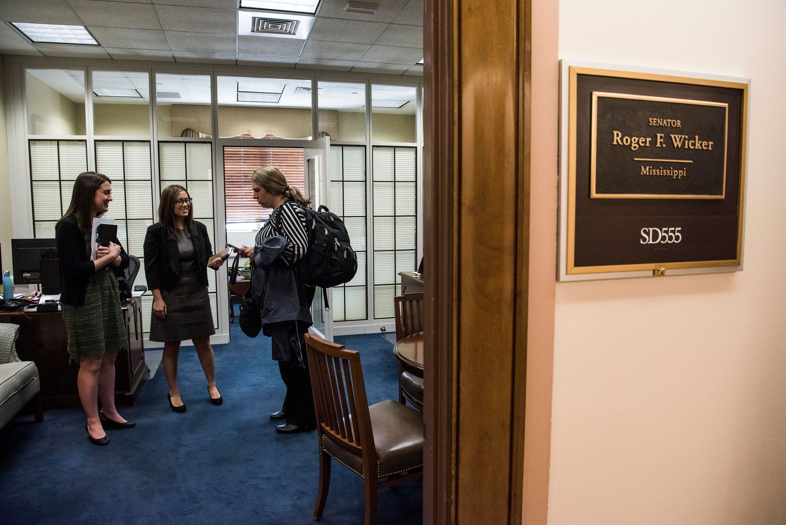 Amber lobbies aides for Sen. Roger Wicker (R-Miss.) in his office at the Dirksen Senate Office Building on Capitol Hill. The