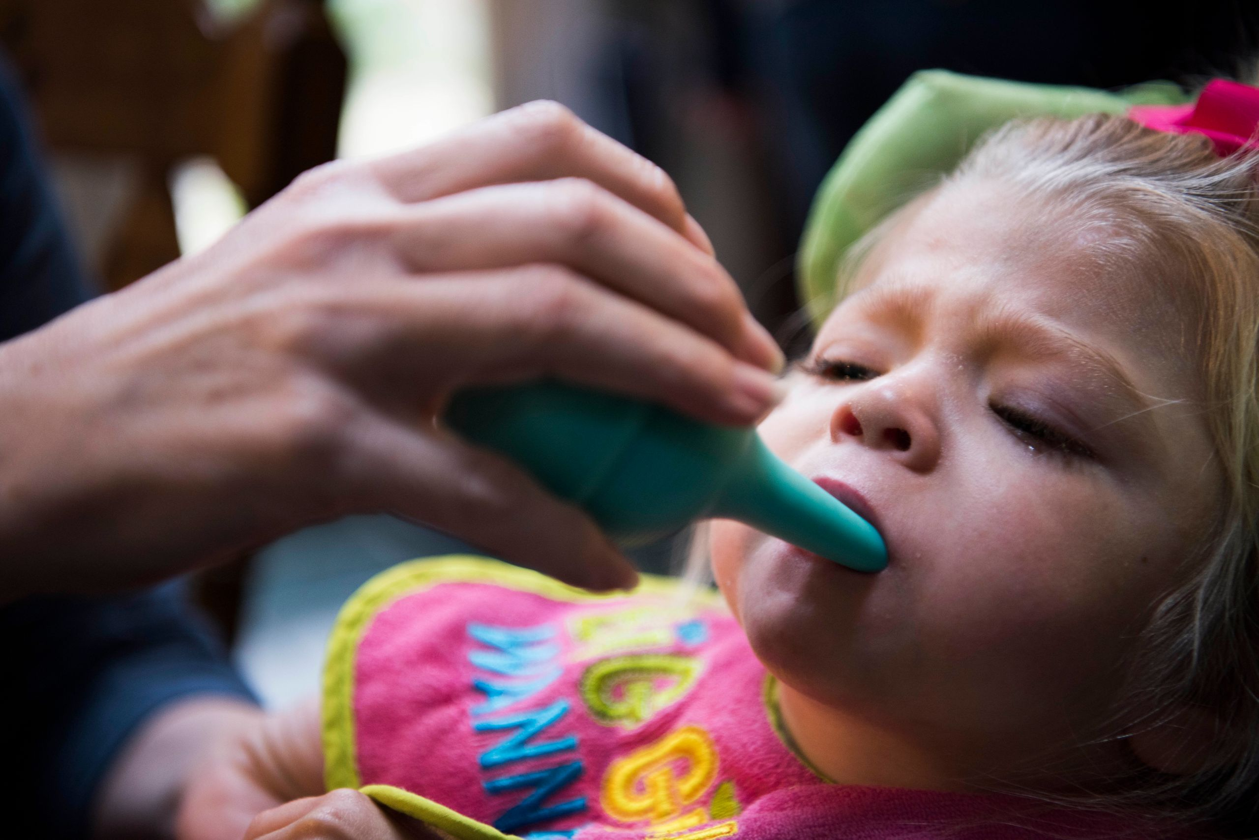 As Willow chokes on her own saliva, Glenda uses a suction tool to clear the girl's airway so she can breathe.