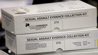 This Feb. 8, 2017, photo, sexual assault evidence collection kit are shown during committee meeting at the Utah State Capitol, in Salt Lake City. Utah crime lab officials are feeling optimistic as they work to speed up the time it takes to process sexual assault evidence kits, after lawmakers approved a measure last month that sends more than $1 million to go toward this effort. (AP Photo/Rick Bowmer)
