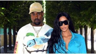 Kim Kardashian & Kanye West Don Matching Outfits During Trip To Uganda
