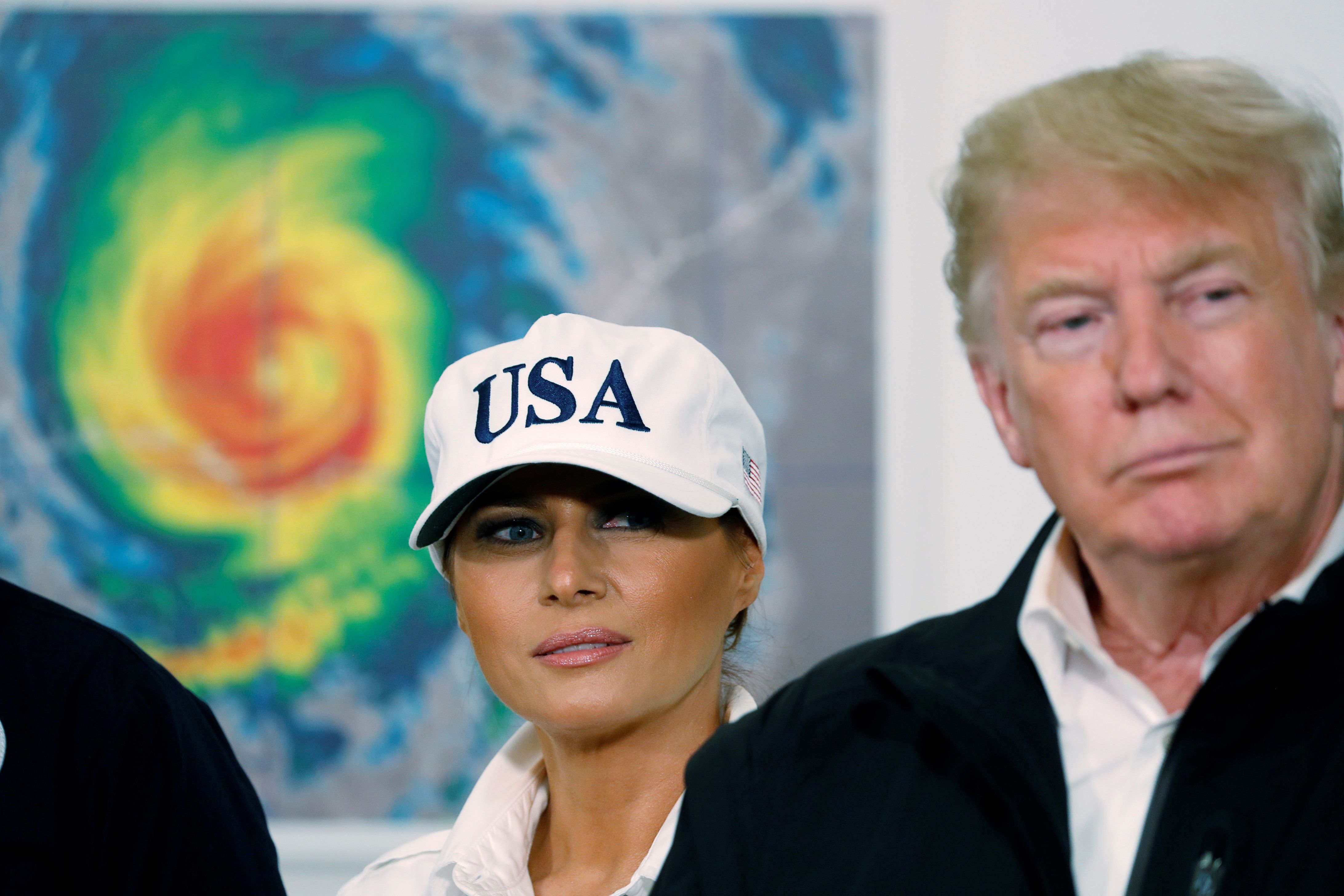U.S. first lady Melania Trump and President Donald Trump listen as they participate in a briefing about the damage caused by Hurricane Michael in Macon, Georgia, U.S., October 15, 2018. REUTERS/Kevin Lamarque