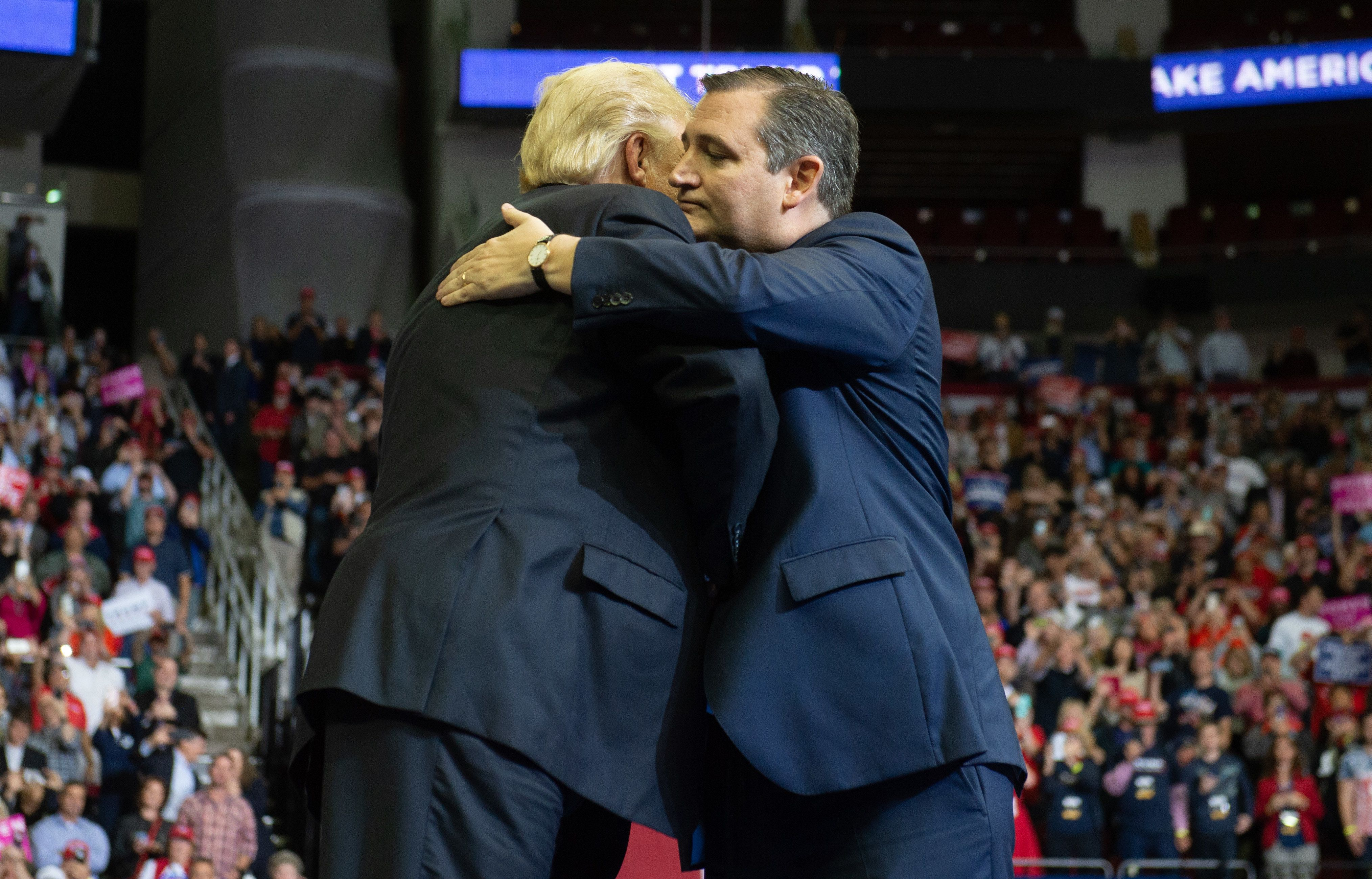 US President Donald Trump greets US Senator Ted Cruz (R), Republican of Texas, during a campaign rally at the Toyota Center in Houston, Texas, on October 22, 2018. (Photo by SAUL LOEB / AFP)        (Photo credit should read SAUL LOEB/AFP/Getty Images)