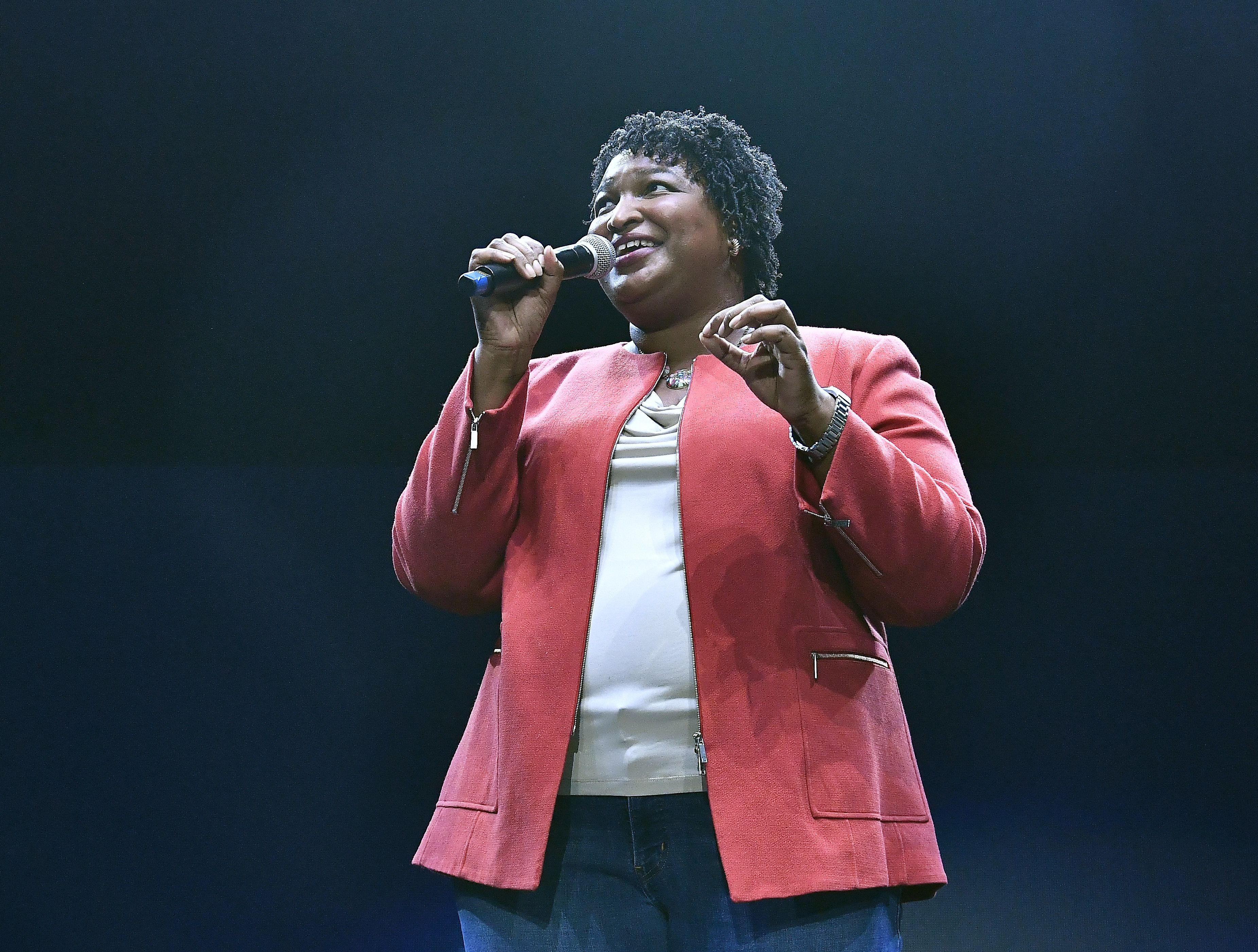 The ACLU's ad seeks to remind voters of Stacey Abrams' work with popular GOP Gov. Nathan Deal.