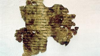 A 2000- year old scroll found at Qumran near the Dead Sea. The text of the scroll is a commentary on the biblical verses of Hosea 2: 8- 14 , which relate God, as husband, to Israel, the unfaithful wife. (AP Photo/ HO: Courtesy of the Israel Antiquities Authority)